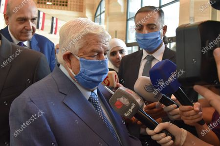 Syrian Foreign Minister Walid al-Moallem speaks to reporter after casting his vote in the People's Assembly (parliament) elections in Damascus, Syria, 19 July 2020. According to reports, 250 Syrian MPs will be elected by direct vote for a four-year term. A total of 1656 candidates are participating in this election process, including 200 women.
