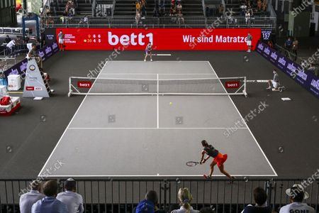 Andrea Petkovic (front) of Germany in action against Elina Svitolina of Ukraine during their 3rd place match f the bett1ACES tennis tournament held at Hanger 6 of the inoperative Tempelhofer airport, in Berlin, Germany, 19 July 2020.  The second part of the exhibition tournament will be played on a hard surface, in an airport hanger converted to a small tennis stadium and will be held under strict hygiene restrictions made to cope with the spread of the coronavirus SARS-CoV-2 which causes the COVID-19 disease.