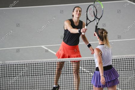 Andrea Petkovic (L) of Germany bumps rackets with Elina Svitolina of Ukraine after their 3rd place match f the bett1ACES tennis tournament held at Hanger 6 of the inoperative Tempelhofer airport, in Berlin, Germany, 19 July 2020.  The second part of the exhibition tournament will be played on a hard surface, in an airport hanger converted to a small tennis stadium and will be held under strict hygiene restrictions made to cope with the spread of the coronavirus SARS-CoV-2 which causes the COVID-19 disease.