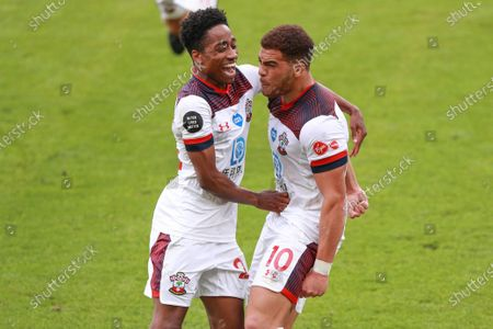 Stock Image of Southampton's Che Adams, right, celebrates with Kyle Walker-Peters after scoring his side's second goal during the English Premier League soccer match between Bournemouth and Southampton at Vitality Stadium in Bournemouth, England