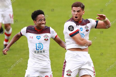 Stock Photo of Southampton's Che Adams, right, celebrates with Kyle Walker-Peters after scoring his side's second goal during the English Premier League soccer match between Bournemouth and Southampton at Vitality Stadium in Bournemouth, England