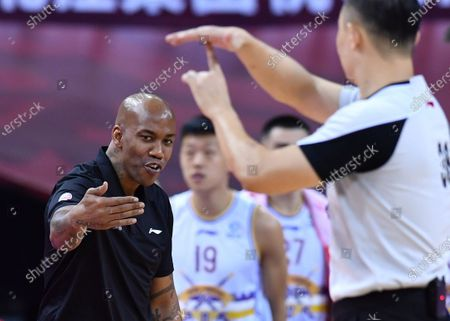 Stock Photo of Stephon Marbury (L), head coach of Beijing Royal Fighters, reacts during a match between Beijing Royal Fighters and Liaoning Flying Leopards at the 2019-2020 Chinese Basketball Association (CBA) league in Qingdao, east China's Shandong Province, July 19, 2020.