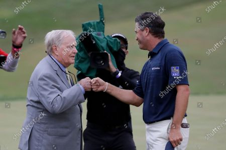 Ryan Palmer, right, fist bumps Jack Nicklaus after the final round of the Memorial golf tournament, in Dublin, Ohio