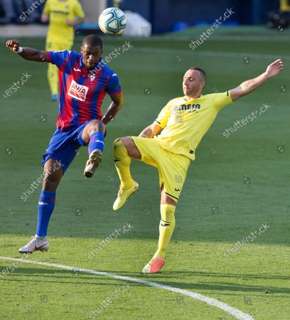 Stock Photo of Villarreal's Santi Cazorla (R) in action against SD Eibar's Pape Diop (L) during the Spanish LaLiga soccer match between Villarreal CF and SD Eibar held at La Ceramica stadium, in Villarreal, Spain, 19 July 2020.