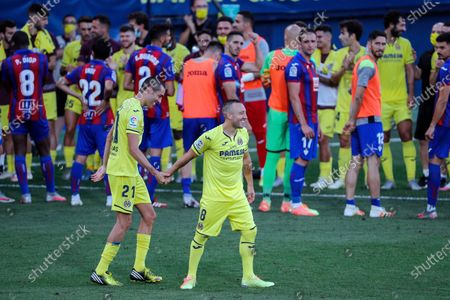Villarreal's Santi Cazorla (R) and Bruno Soriano (L) react after their last game with the team at the end of the Spanish LaLiga soccer match between Villarreal CF and SD Eibar held at La Ceramica stadium, in Villarreal, Spain, 19 July 2020.