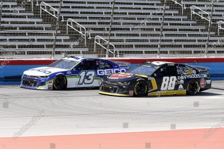 Ty Dillon (13) and Alex Bowman (88) race down the front stretch during a NASCAR Cup Series auto race at Texas Motor Speedway in Fort Worth, Texas
