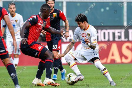 Genoa's Cristian Zapata (C) and Lecce's Diego Farias (R) vie for the ball during the Italian Serie A soccer match Genoa Cfc vs Us Lecce at Luigi Ferraris stadium in Genoa, Italy, 19 July 2020.