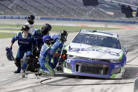The pit crew of Ty Dillon removes a piece of front fender in the pits during a NASCAR Cup Series auto race at Texas Motor Speedway in Fort Worth, Texas