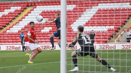 Michael Dawson goes close with a header during the SkyBet Championship game between Barnsley and Nottingham Forest at Oakwell Stadium.