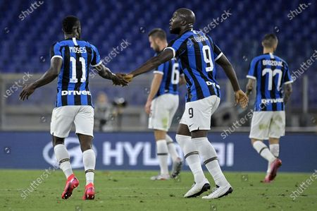 Inter's Romelu Lukaku (R) celebrates his goal with Inter's Victor Moses (L) during the Italian Serie A soccer match between AS Roma and FC Inter at the Olimpico stadium in Rome, Italy, 19 July 2020.