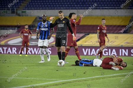 Inter's Victor Moses (L) on the ground after being fouled by Roma's Leonardo Spinazzola (R) in Roma's box during the Italian Serie A soccer match between AS Roma and FC Inter at the Olimpico stadium in Rome, Italy, 19 July 2020.