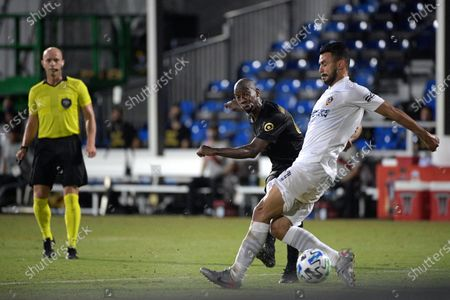 Stock Picture of Los Angeles FC forward Bradley Wright-Phillips (66), center, scores a goal past LA Galaxy defender Giancarlo Gonzalez, right, during the second half of an MLS soccer match, in Kissimmee, Fla
