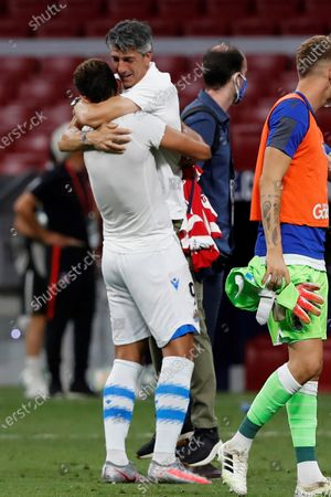 Real Sociedad's head coach Imanol Arias (R) celebrates as the team has qualified for Europe League next season after the Spanish LaLiga soccer match between Atletico Madrid and Real Sociedad held at Wanda Metropolitano stadium, in Madrid, Spain, 19 July 2020.