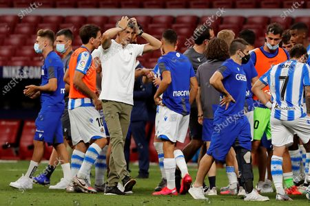 Real Sociedad's head coach Imanol Arias (3-L) celebrates as the team has qualified for Europe League next season after the Spanish LaLiga soccer match between Atletico Madrid and Real Sociedad held at Wanda Metropolitano stadium, in Madrid, Spain, 19 July 2020.