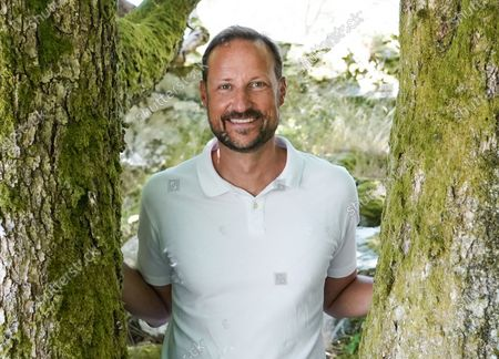 Crown Prince Haakon, the heir apparent to the Norwegian throne, poses for a portrait during his family's summer vacation on the island of Dvergsoya, Kristiansand, southern Norway, 19 July 2020.