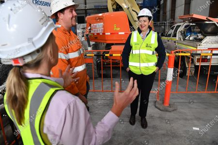 Queensland Premier Annastacia Palaszczuk (R) talks to Cross River Rail project apprentice Adam Wormald (C) and the Minister for State Development, Tourism and Innovation, Kate Jones (L) in Brisbane, Australia, 20 July 2020. Premier Palaszczuk met with workers and inspected work on the Cross River Rail project in Brisbane's CBD.