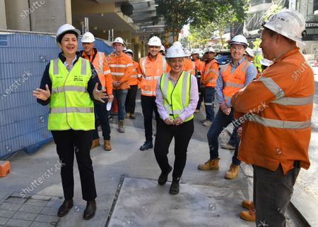 Queensland Premier Annastacia Palaszczuk (L) and the Minister for State Development, Tourism and Innovation, Kate Jones (R) participate in a press conference in Brisbane, Australia, 20 July 2020. Premier Palaszczuk met with workers and inspected work on the Cross River Rail project in Brisbane's CBD.