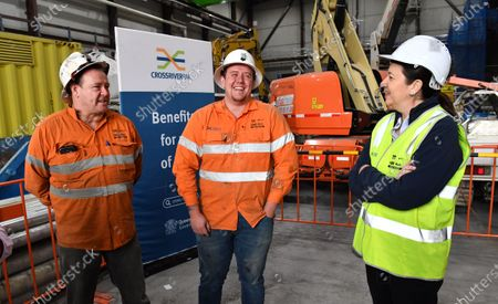 Queensland Premier Annastacia Palaszczuk (R) talks to Cross River Rail project father and son workers Shane (L) and Adam Wormald (C) in Brisbane, Australia, 20 July 2020. Premier Palaszczuk met with workers and inspected work on the Cross River Rail project in Brisbane's CBD.