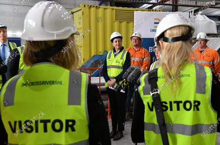 Queensland Premier Annastacia Palaszczuk (C) speaks during a press conference in Brisbane, Australia, 20 July 2020. Premier Palaszczuk met with workers and inspected work on the Cross River Rail project in Brisbane's CBD.