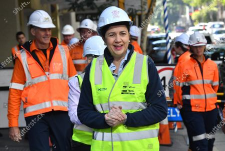 Queensland Premier Annastacia Palaszczuk (C) arrives for a press conference in Brisbane, Australia, 20 July 2020. Premier Palaszczuk met with workers and inspected work on the Cross River Rail project in Brisbane's CBD.