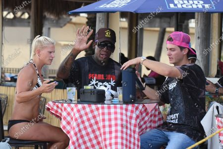 Tania Fendrich, left, Dennis Rodman, and Garrett. Dennis Rodman is sighted on Hollywood Beach Boardwalk. Broward County is now under nightly curfew to combat the coronavirus. The curfew is in place from 11 p.m. to 5 a.m. daily. The new restrictions come under an emergency order issued Friday afternoon Florida reported more than 12,400 new cases Sunday, bringing the state's total to more than 350,000 on Sunday, in Hollywood Beach, Florida, USA - 19 July 2020
