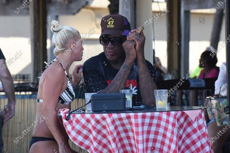 Tania Fendrich, left, Dennis Rodman. Dennis Rodman is sighted on Hollywood Beach Boardwalk. Broward County is now under nightly curfew to combat the coronavirus. The curfew is in place from 11 p.m. to 5 a.m. daily. The new restrictions come under an emergency order issued Friday afternoon Florida reported more than 12,400 new cases Sunday, bringing the state's total to more than 350,000 on Sunday, in Hollywood Beach, Florida, USA - 19 July 2020