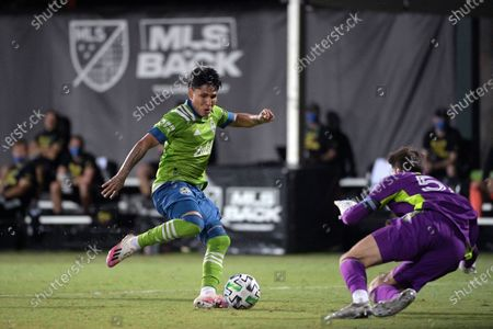 Seattle Sounders forward Raul Ruidiaz, left, has his shot blocked by Vancouver Whitecaps goalkeeper Thomas Hasal (51) during the second half of an MLS soccer match, in Kissimmee, Fla