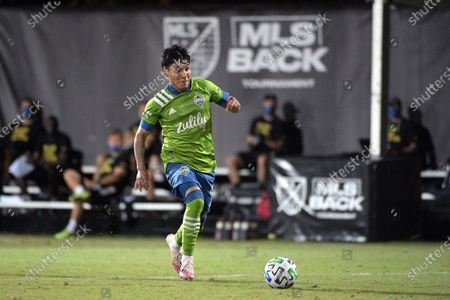 Seattle Sounders forward Raul Ruidiaz controls a ball during the second half of an MLS soccer match against the Vancouver Whitecaps, in Kissimmee, Fla