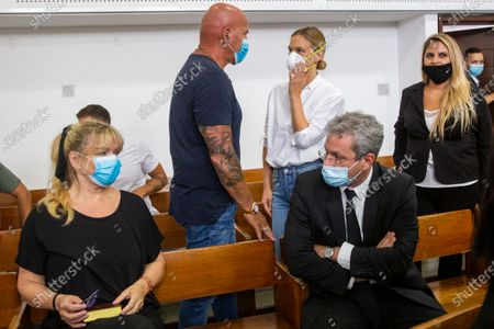 Israeli top model Bar Refaeli (C-R) wearing a face mask arrives to a court along with her mother, Zipi (L), her father Raffi (2-R) and lawyers, in Tel Aviv, Israel, 20 July 2020. Refaeli signed a plea bargain agreement with authorities to settle a long-standing tax evasion case against her and her family. The deal will require Refaeli to serve nine months of community service while her mother, Zipi, will be sent to prison for 16 months. The two are also ordered to pay a US dollars 1.5 million fine on top of millions of back taxes owed to the state.