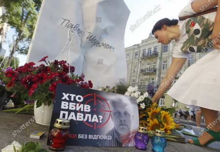 A woman lays flowers to mark the death anniversary of journalist Pavel Sheremet at the place of his killing in Kiev. Four years later journalists and friends of Pavel Sheremet again gathered to honor his memory demanding an investigation in his killing. Belarusian-born Russian and Ukrainian journalist Pavel Sheremet, 44, who worked in Ukrayinska Pravda and Radio Vesti, died in Kyiv on 20 July 2016 in a car explosion. In December 2019 Ukrainian Interior Minister Arsen Avakov said that were arrested war volunteers suspected of killing Pavel Sheremet. Police investigators suspect a group of five people: Andrii Antonenko,Yulia Kuzmenko,Yana Duhar, Inna Hryshchenko and Vladyslav Hryshchenko. On 13 December 2019, two of the suspects, Donbass war veteran and rock-musician Andrii Antonenko and doctor and volunteer Yulia Kuzmenko, were remanded in custody. Ukrainian journalists were sceptical about the evidence and the alleged motive.