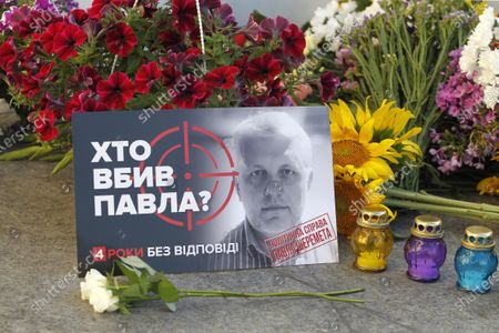 A portrait and flowers  laid at the place of journalist Pavel Sheremet killing to mark his death anniversary in Kiev. Four years later journalists and friends of Pavel Sheremet again gathered to honor his memory demanding an investigation in his killing. Belarusian-born Russian and Ukrainian journalist Pavel Sheremet, 44, who worked in Ukrayinska Pravda and Radio Vesti, died in Kyiv on 20 July 2016 in a car explosion. In December 2019 Ukrainian Interior Minister Arsen Avakov said that were arrested war volunteers suspected of killing Pavel Sheremet. Police investigators suspect a group of five people: Andrii Antonenko,Yulia Kuzmenko,Yana Duhar, Inna Hryshchenko and Vladyslav Hryshchenko. On 13 December 2019, two of the suspects, Donbass war veteran and rock-musician Andrii Antonenko and doctor and volunteer Yulia Kuzmenko, were remanded in custody. Ukrainian journalists were sceptical about the evidence and the alleged motive.