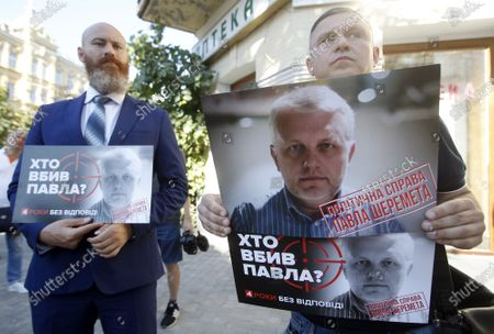 People hold portraits of journalist Pavel Sheremet during the death anniversary at the place of his killing in Kiev. Four years later journalists and friends of Pavel Sheremet again gathered to honor his memory demanding an investigation in his killing. Belarusian-born Russian and Ukrainian journalist Pavel Sheremet, 44, who worked in Ukrayinska Pravda and Radio Vesti, died in Kyiv on 20 July 2016 in a car explosion. In December 2019 Ukrainian Interior Minister Arsen Avakov said that were arrested war volunteers suspected of killing Pavel Sheremet. Police investigators suspect a group of five people: Andrii Antonenko,Yulia Kuzmenko,Yana Duhar, Inna Hryshchenko and Vladyslav Hryshchenko. On 13 December 2019, two of the suspects, Donbass war veteran and rock-musician Andrii Antonenko and doctor and volunteer Yulia Kuzmenko, were remanded in custody. Ukrainian journalists were sceptical about the evidence and the alleged motive.