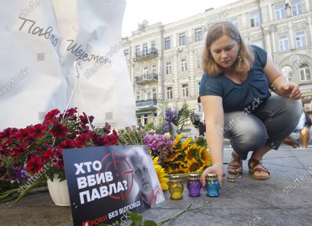 A woman lays a candle to mark the death anniversary of journalist Pavel Sheremet at the place of his killing in Kiev. Four years later journalists and friends of Pavel Sheremet again gathered to honor his memory demanding an investigation in his killing. Belarusian-born Russian and Ukrainian journalist Pavel Sheremet, 44, who worked in Ukrayinska Pravda and Radio Vesti, died in Kyiv on 20 July 2016 in a car explosion. In December 2019 Ukrainian Interior Minister Arsen Avakov said that were arrested war volunteers suspected of killing Pavel Sheremet. Police investigators suspect a group of five people: Andrii Antonenko,Yulia Kuzmenko,Yana Duhar, Inna Hryshchenko and Vladyslav Hryshchenko. On 13 December 2019, two of the suspects, Donbass war veteran and rock-musician Andrii Antonenko and doctor and volunteer Yulia Kuzmenko, were remanded in custody. Ukrainian journalists were sceptical about the evidence and the alleged motive.