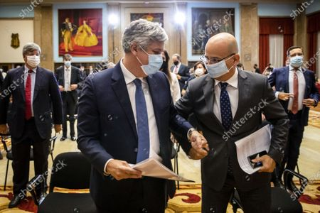 Former Finance Minister and former Eurogroup President, Mario Centeno (L), greets the Finance Minister, Joao Leao (R), in the end of his presentation ceremony as the new governor of Portugal Bank, at the Finance Ministery, in Lisbon, Portugal, 20 July 2020. Venteno became the new Governor of the Bank of Portugal.