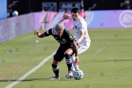 New York City FC defender Ronald Matarrita, left, tries to get possession of the ball in front of Inter Miami midfielder Lewis Morgan during the first half of an MLS soccer match, in Kissimmee, Fla