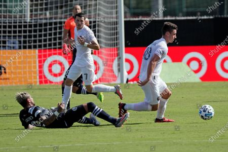 Inter Miami defender Dylan Nealis, right, clears the ball from New York City FC defender Ronald Matarrita, left, as Inter Miami midfielder Lewis Morgan (7) comes to help during the first half of an MLS soccer match, in Kissimmee, Fla