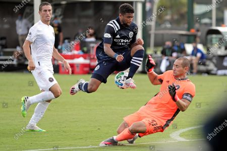 Stock Image of Inter Miami goalkeeper Luis Robles (31) blocks a shot by New York City FC midfielder Ismael Tajouri-Shradi, center, as Inter Miami defender Ben Sweat, left, looks on during the second half of an MLS soccer match, in Kissimmee, Fla