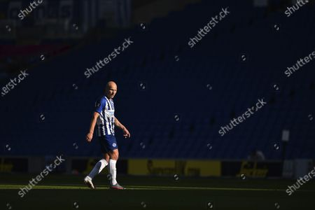 Brighton's Aaron Mooy gestures during the English Premier League soccer match between Brighton and Newcastle United at the American Express Community Stadium in Brighton, England