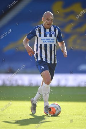 Brighton's Aaron Mooy runs with the ball during the English Premier League soccer match between Brighton and Newcastle United at the American Express Community Stadium in Brighton, England