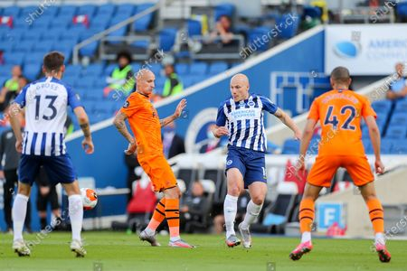 Brighton and Hove Albion midfielder Aaron Mooy (18) battles with Newcastle United midfielder Jonjo Shelvey (8) during the Premier League match between Brighton and Hove Albion and Newcastle United at the American Express Community Stadium, Brighton and Hove