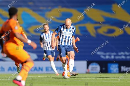 Brighton and Hove Albion midfielder Aaron Mooy (18) during the Premier League match between Brighton and Hove Albion and Newcastle United at the American Express Community Stadium, Brighton and Hove
