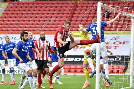 Sheffield United's Jack O'Connell, center, attempts a shot near the net of Everton's goalkeeper Jordan Pickford, second from right, during the English Premier League soccer match between Sheffield United and Everton at Bramall Lane in Sheffield, England