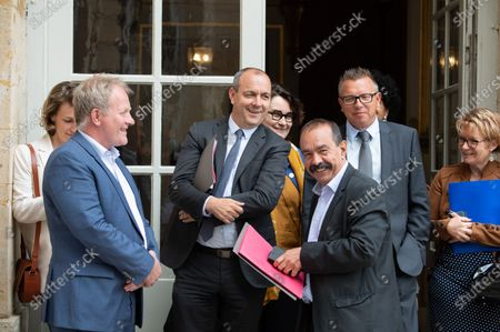 Francois Hommeril (Cfe-Cgc), Laurent Berger (Cfdt), a gust, Philippe Martinez (CGT), Cyril Chabanier (Cftc) and Pascale Coton (Cftc) leave after attending a social dialogue conference with social partners at the Matignon Hotel.