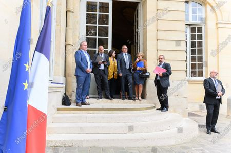 Stock Photo of Francois Hommeril (Cfe-Cgc), Laurent Berger (Cfdt), a guest,  Cyril Chabanier (Cftc), Pascale Coton (Cftc), Philippe Martinez (CGT) and Pierre Burban (U2P) leave after attending a social dialogue conference with social partners at the Matignon Hotel.