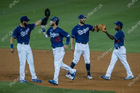 Los Angeles, CA, Sunday, July 19, 2020 - Dodgers players celebrate a 9-1 win over the Diamondbacks at Dodger Stadium. Left to right, Edwin Rios, Cody Bellinger, Chris Tayler and Terrence Gore. (Robert Gauthier / Los Angeles Times)