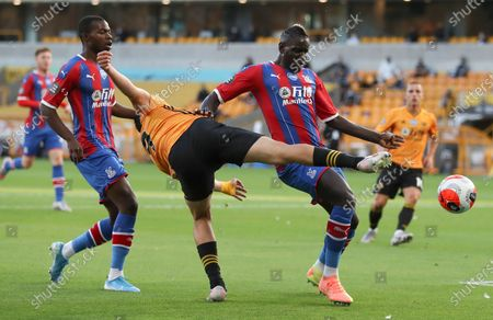 Wolverhampton Wanderers' Raul Jimenez, centre, battles for the ball with Crystal Palace's Mamadou Sakho, right, during the English Premier League soccer match between Wolverhampton Wanderers and Crystal Palace at Molineux Stadium in Wolverhampton, England