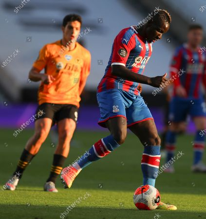Crystal Palace's Mamadou Sakho looks to kick the ball during the English Premier League soccer match between Wolverhampton Wanderers and Crystal Palace at Molineux Stadium in Wolverhampton, England