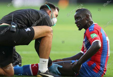 Crystal Palace's Mamadou Sakho receives treatment during the English Premier League soccer match between Wolverhampton Wanderers and Crystal Palace at Molineux Stadium in Wolverhampton, England