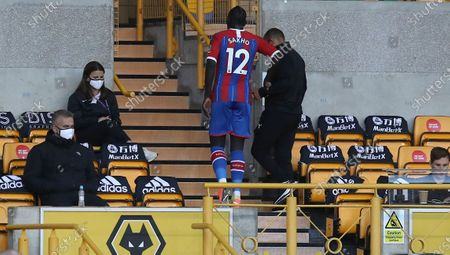 Crystal Palace's Mamadou Sakho leaves the field injured during the English Premier League soccer match between Wolverhampton Wanderers and Crystal Palace at Molineux Stadium in Wolverhampton, England