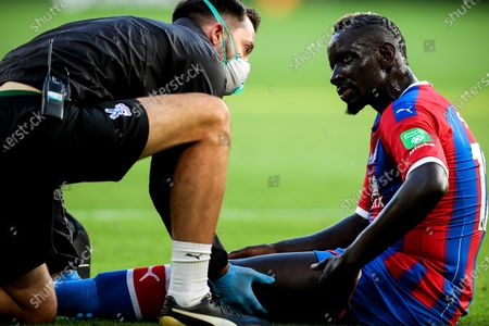 Crystal Palace's Mamadou Sakho (R) reacts as he gets medical assistance during the English Premier League soccer match between Wolverhampton Wanderers and Crystal Palace in Wolverhampton, Britain, 20 July 2020.